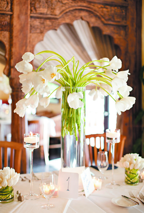Tables were decorated with tall displays of white French tulips, with candles and additional tulip centerpieces arranged at the base. All flowers were by The Epicure Florist.