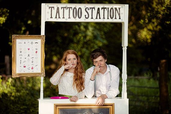 A temporary tattoo booth for the reception | Credit: Tim Simpson Photography