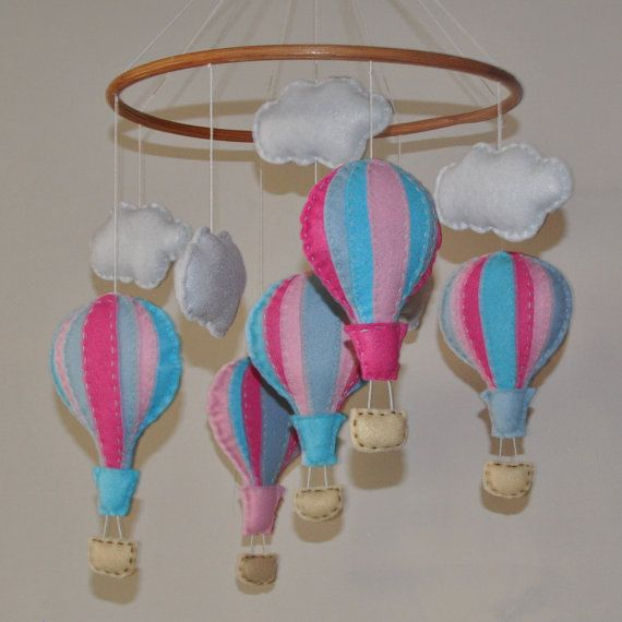 This mobile has been made with love and care.  The hot air balloons will gently float through the clouds and delight your precious little one.