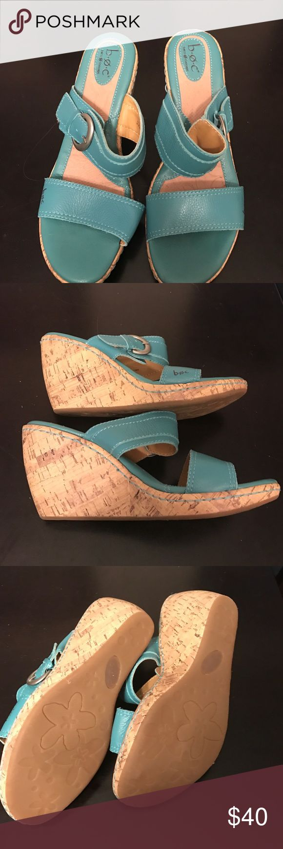 B.o.c. Turquoise wedge sandals, size 10 If he you look at my listings, you can see I have a lot of size 10 shoes I've never worn. I have a problem. The shoes are beautiful, but they should go to someone who was going to wear them. The turquoise sandal is accented with the silver buckle on the side that is adjustable. The wedge is gradual, and at its highest, it is 3 1/2 inches high. b.o.c. Shoes Sandals