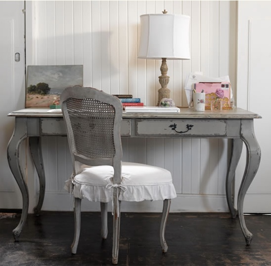 Paint a wooden desk, then use tinted furniture wax to make it look worn & loved.