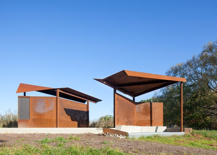 Plant Architect has used weathering steel to create wing-like structures for bird watchers in a Toronto park, punctured with patterns and information
