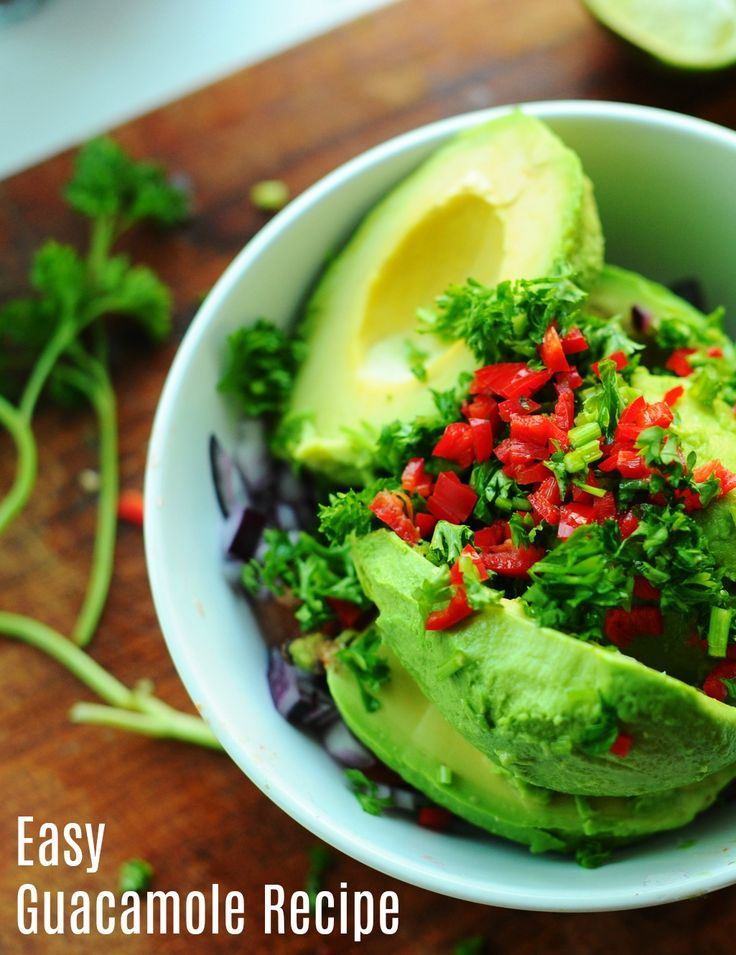 How to make guacamole! It's EASY! Get this simple guacamole recipe here and you'll be hooked! You'll soon be putting guacamole on everything - toast, tacos, chicken, tortilla chips and more!