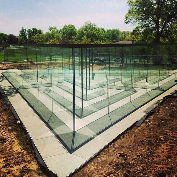 Robert Morris: Glass Labyrinth, 2014. Outdoor sculpture installation that takes the form of a navigable, glass-walled labyrinth. In 2014 the installation was unveiled at the Donald J. Hall Sculpture Park at The Nelson-Atkins Museum of Art in Kansas City, Missouri.