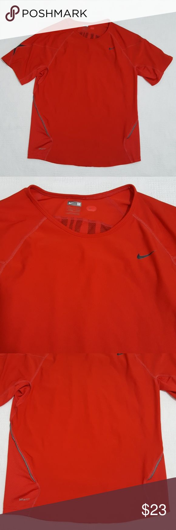 Nike Fit Dry Red Short Sleeve Top - Medium This is a size medium short sleeve dri-fit top from Nike. Normal wear, please see last photo for a few spots near back of neckline. No holes or tears. Great for working out, running, playing soccer or other high impact sport. 178cm.  Bundle & save.  8107 Nike Shirts Tees - Short Sleeve