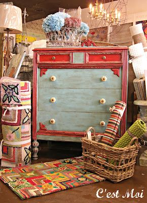C'est Moi: The dresser shows off a quirky combination of Annie Sloan CHALK PAINT™.  Layered Emperor's Silk and Provence over Arles and Chateau Grey, which peek through the outer layers and dark wax ever so slightly.