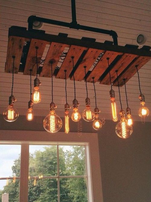 Use oversized antique bulbs and a wooden pallet to make a statement over a kitchen island.