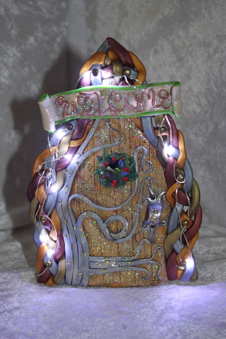 Free standing faery door with battery operated LED lights (batteries not included) by Faerytastic on Etsy https://www.etsy.com/listing/256737325/free-standing-faery-door-with-battery