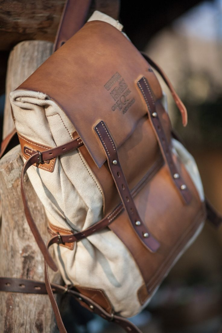 medium-size leather and canvas backpack