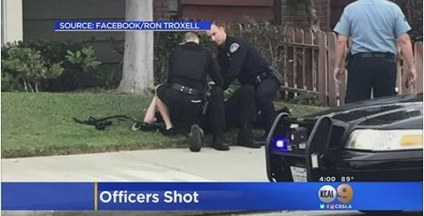 Huntington Beach police officers injured by 'friendly fire' while confronting suspect