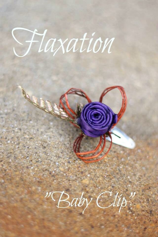 We have had the pleasure of creating a teeny tiny hair clip for a little baby with very fine hair. Thus was made to match her mums bouquet. www.flaxation.co.nz