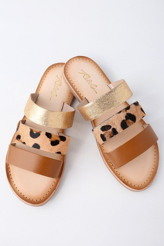 Create a bold look from head to toe by adding the Rebels Jaylen Natural Leather Slide Sandals to any outfit! Tan, cheetah pony fur, and metallic gold genuine leather straps create a multi-tonal look across these chic slide sandals.