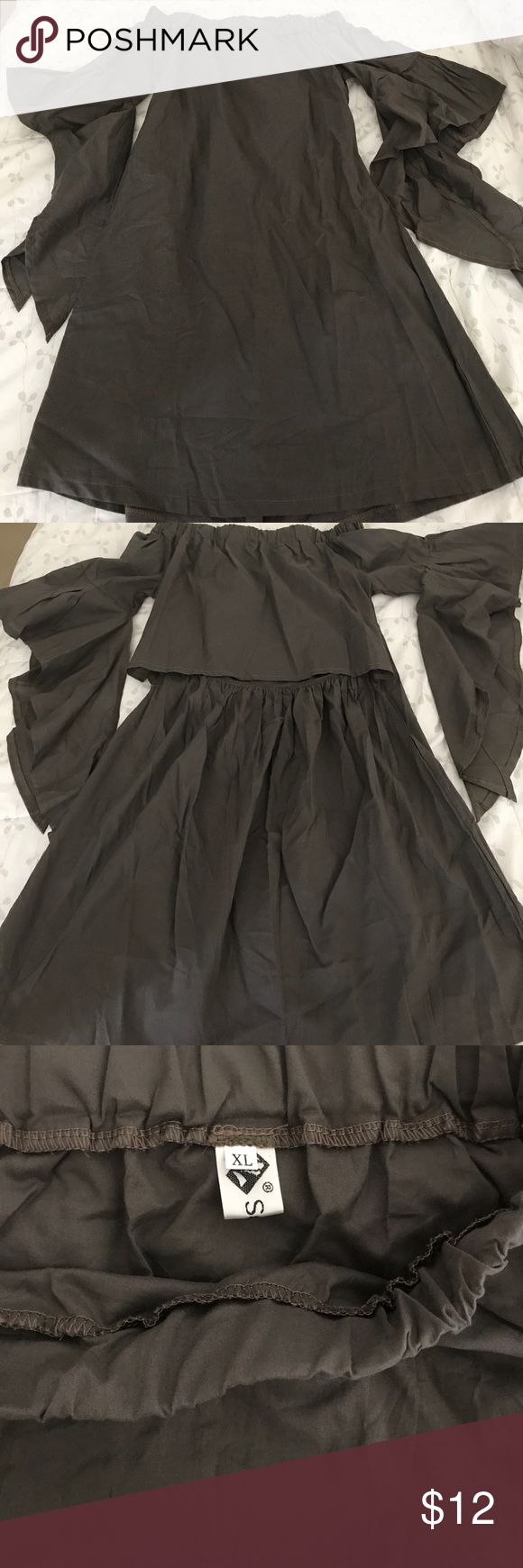 NWOT Off shoulder grey dress with flowing sleeves Dark gray off the shoulder dress with flowing sleeves size extra-large runs very small. Would fit a size 4–6. Very fun summer dress. Dresses