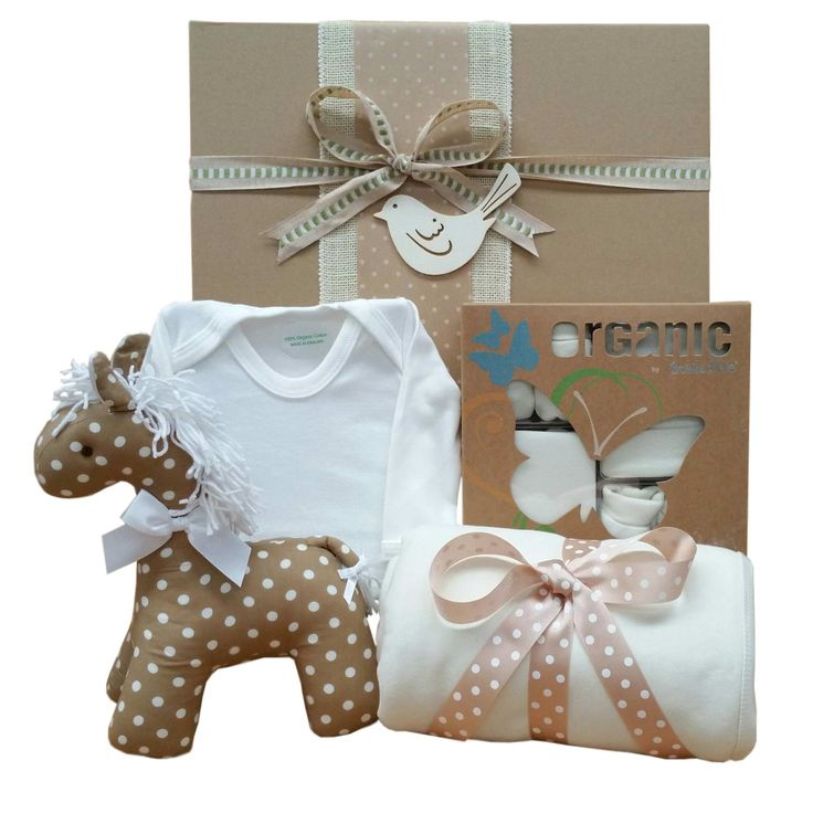 Gorgeous Kate Finn spotty horse rattle along with Bubba Blue organic baby clothing and organic baby wrap.