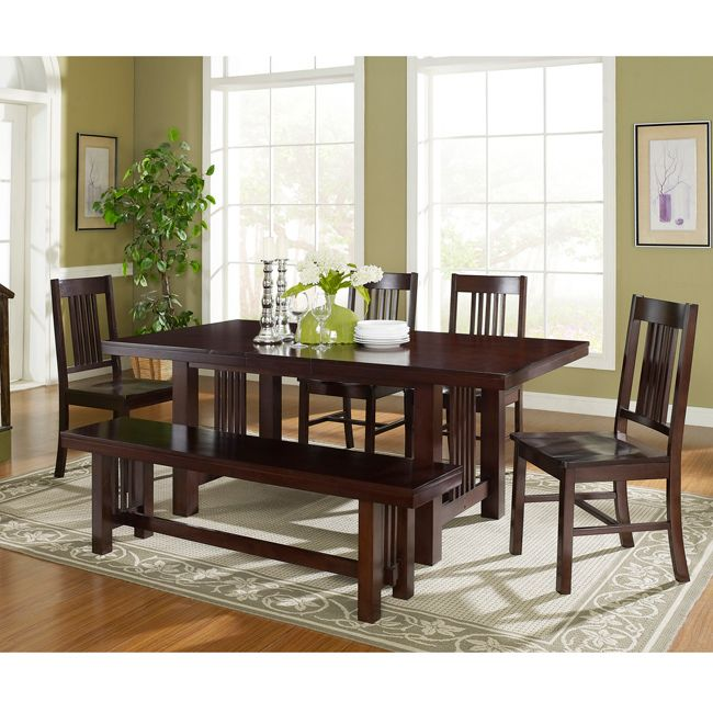 Give your dining room a beautiful wooden centerpiece with this solid-wood dining set. The dining set includes a table, four chairs, and a bench, all in an attractive cappuccino finish. The set provides plenty of space for family meals or entertaining.