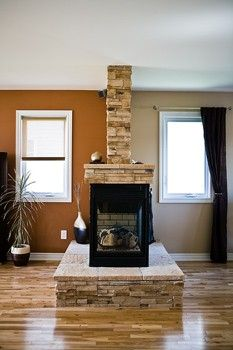 Hmmm. Wonder if I could do this to our awkwardly placed pellet stove. Give it a mantle and make it useful!