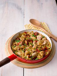 Skillet Chicken And Rice - Healthy - olive oil - kielbasa or sausage - chicken - sliced bell peppers - onions - garlic - Cajun seasoning - 3 cups brown rice - frozen peas - chicken broth