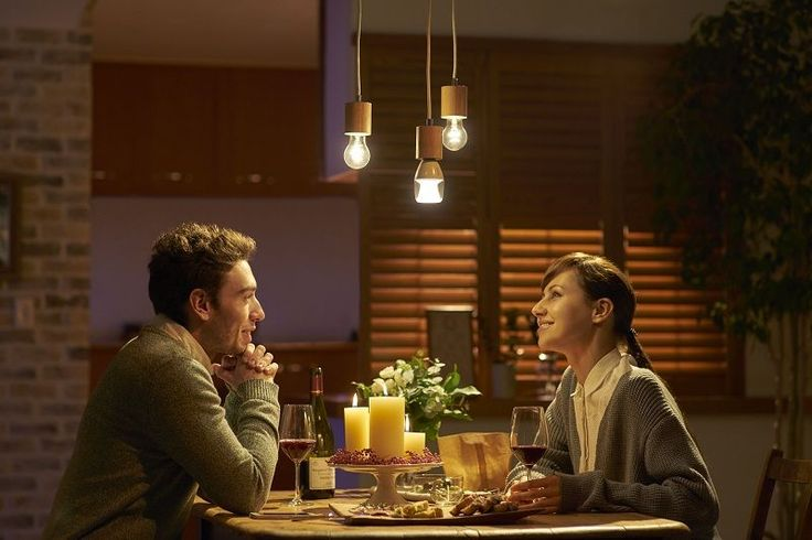 Image result for couple sitting at table warm light
