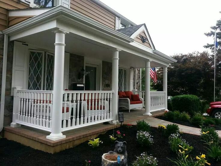 Covered Front Porch With Railings Round Columns Paver