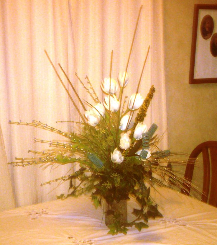 Special Foam Floral design with teal curling accents and greenery