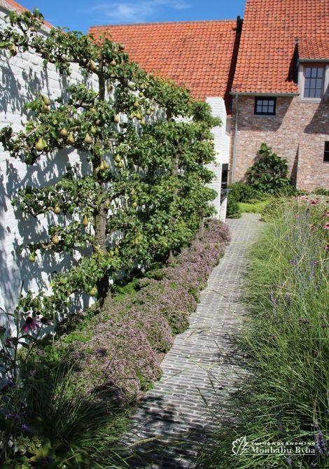 Aangelegde tuinen door tuinonderneming Monbaliu - De Vlaams landelijke stijl met…