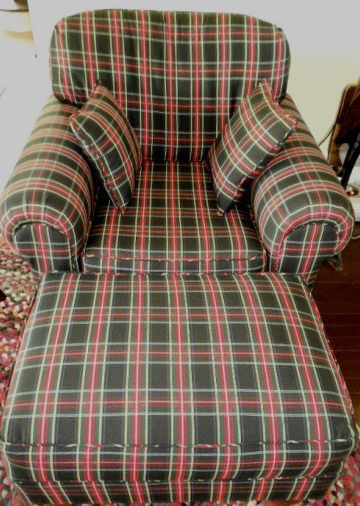 Black Stewart Upholstered Chair And Ottoman.