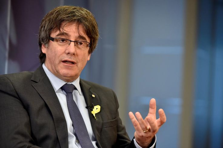 Catalonia's former leader Carles Puigdemont on Saturday urged Spanish Prime Minister Mariano Rajoy to accept the results of a Dec. 21 local election which gave a slim majority to parties favoring a split of the northeastern region from Spain.