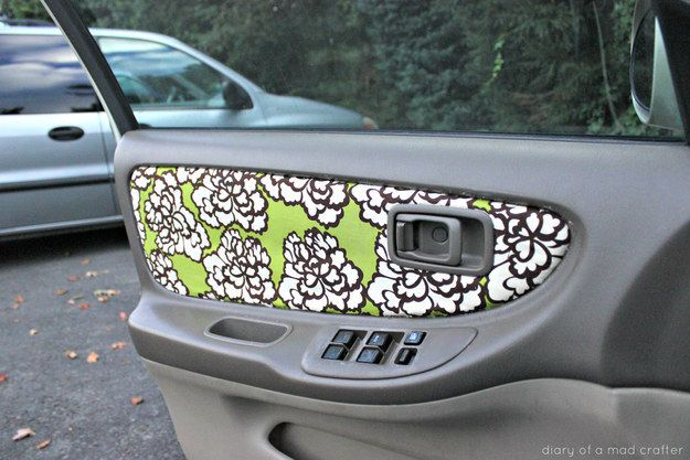 Reupholster your car door with a fabric of your choice.