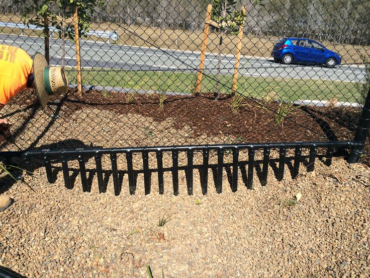 This is a solution where a chainwire fence crosses over a drain maintaining security.