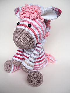 The Zoe zebra pattern is a color variation on the pattern of donkey Alex. If you buy the pattern for Zoe zebra, you receive the base pattern for donkey Alex for free.