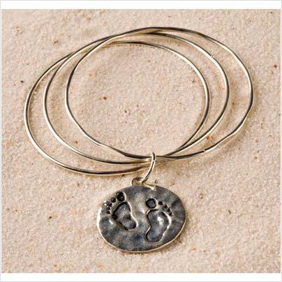 """A three bangle bracelet is held together with a medallion that offers a warm reminder to keep close at hand. """"Follow the Footprints of the Lord, they will lead you through troubled times."""" Reverse side of medallion shows two footprints. A wonderful gift idea for friends and family...or yourself! $12.00"""