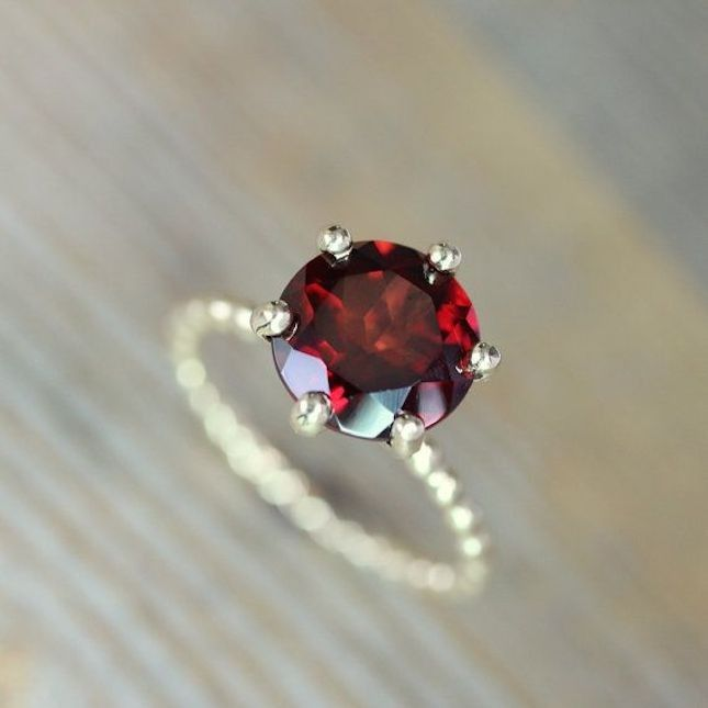 Stun with this red garnet + recycled gold engagement ring.