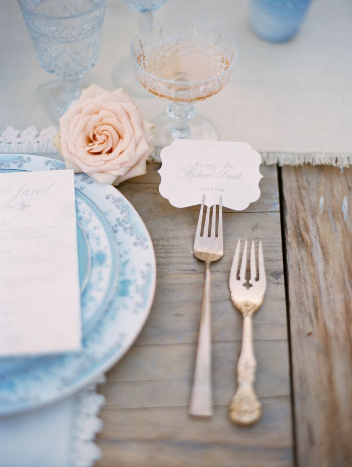 Loving Archive Rentals beautiful blue china, stunning glass goblets, and rose gold forks! Especially in love with how Intertwined Events used the fork to display the escort cards!