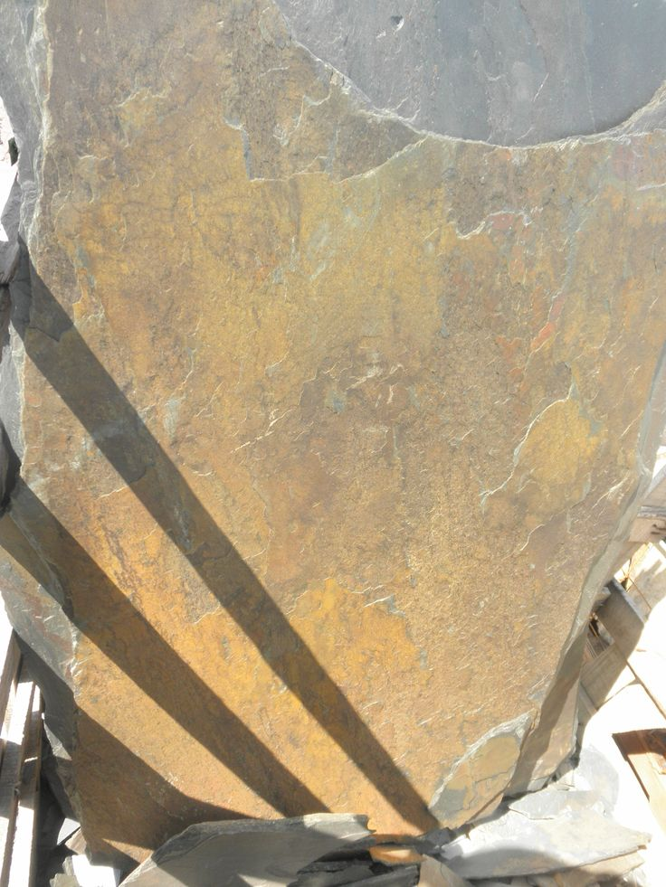 California Gold Slate Flagstone  This stone is imported from India, just our opinion but perhaps Bollywood Gold would be more accurate name. California Gold is a random slate flagstone featuring rust, tan and gray hues....http://www.earthstonerock.com/California-Gold-Flagstone-Prices-s/309.htm
