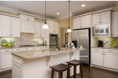 The Georgetown with Sunroom by Goodall Homes at Foxland Harbor Villas