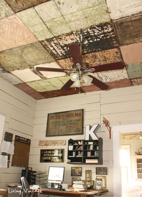 Reclaimed vintage tin ceiling.  Love the patchwork effect!  From livingvintageco.com
