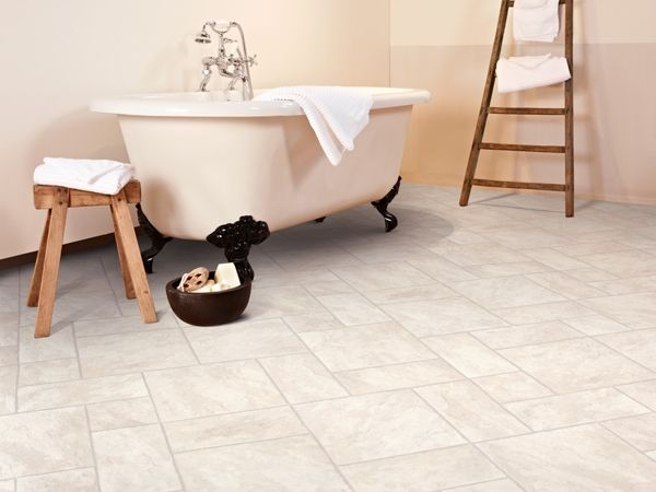 Vinyl tiles give the gorgeous look of ceramic tiles but without that shock of bare feet on a cold bathroom floor!