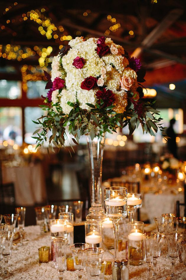 Tall thin stemmed glass vases are always a good option for centre pieces so as not to obscure the vision of the guest sitting opposite each other