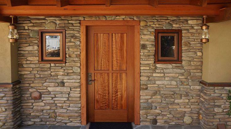 Split curly redwood panel door built for Santa Cruz Timberframes.