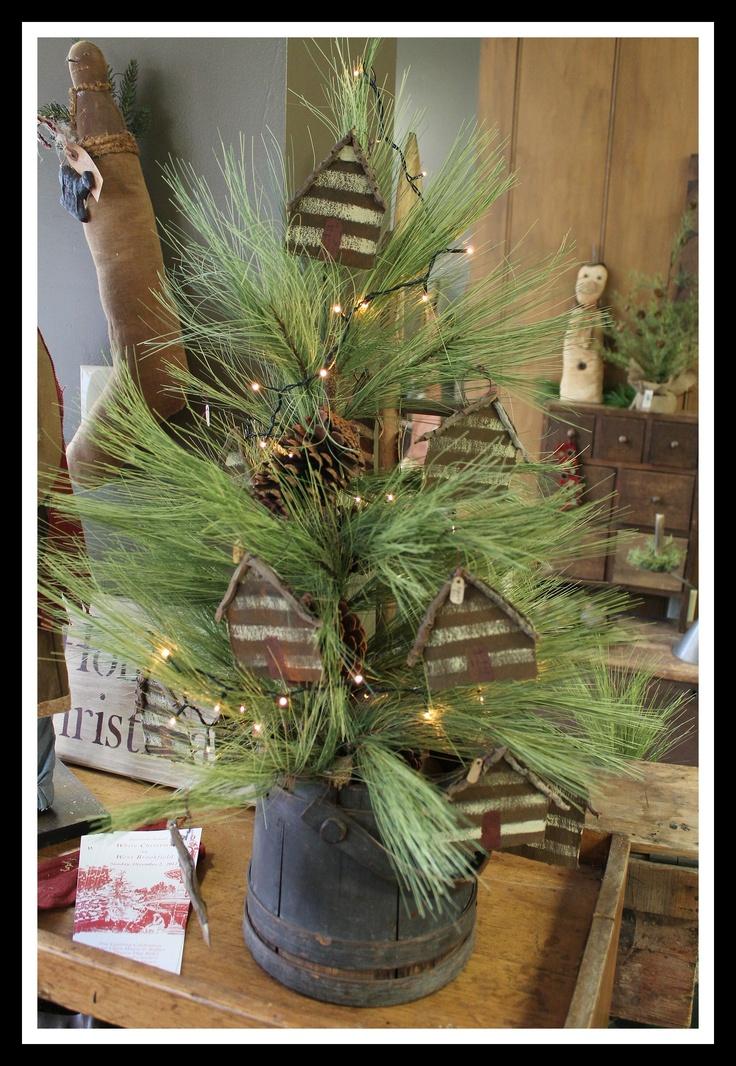 Prim Log Cabin Tree...stuffed in an old wooden bucket.