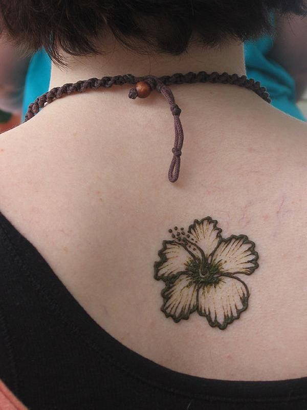 http://slodive.com/wp-content/uploads/2012/03/simple-tattoos/hibiscus-tattoo.jpg this is exactly what I want on my shoulder some day.