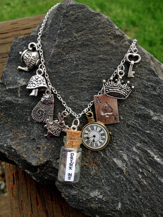 Alice In Wonderland Drink Me Vial Necklace with 8 Charms, Sterling Silver 925 via Etsy