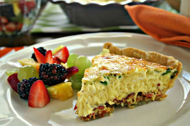 Classic Quiche Lorraine, a savory egg custard baked in a pie crust with crisp-fried bacon, scallions, and Swiss cheese.