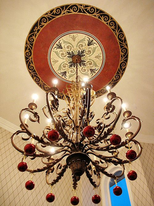 Stenciling can also add visual weight to a light fixture while incorporating color and pattern.  The ceiling medallion was first painted on canvas by artist Jeff Raum and then installed. It used a modified Modello Designs Ornamental Center stencil (OrnCen 128).  www.ModelloDesigns.com