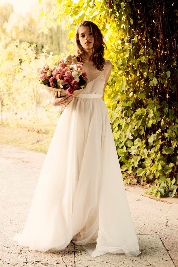Milk shade open back wedding dress with cotton slip / http://www.deerpearlflowers.com/unique-sophisticated-wedding-dresses-from-cathy-telle/3/