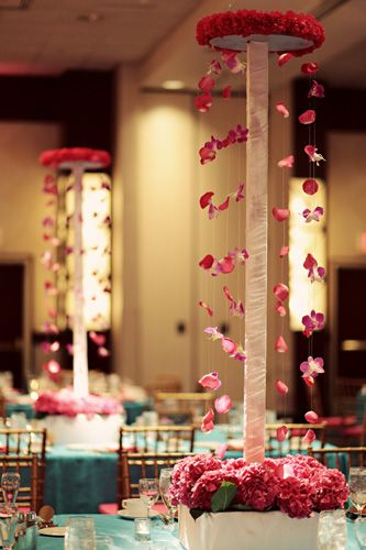 unique centerpiece with strung flowers -- looks like the side of a mandap