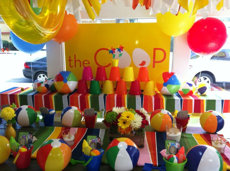 BEACH BALL PARTYBuckets Stacked With Pinwheels On Top