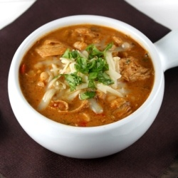 Chicken chili with navy beans and topped with pepper jack cheese and cilantro