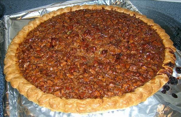 Utterly Deadly Southern Pecan Pie. I melted the butter in the syrup mixture after I took it off the stove then poured it in the eggs. I used chopped pecans in the filling and put some halves on top to make it pretty. I put it in the oven on a flat pan and covered with tinfoil for 60 minutes then uncovered for 15 minutes.