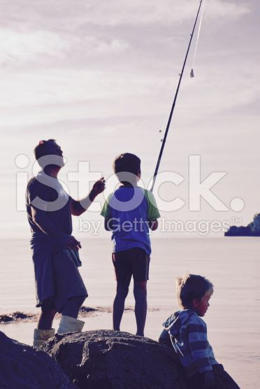 Father and Sons Fishing royalty-free stock photo